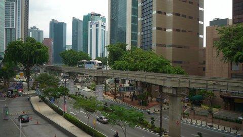 kuala lumpur city center day time traffic street monorail rooftop panorama 4k malaysia