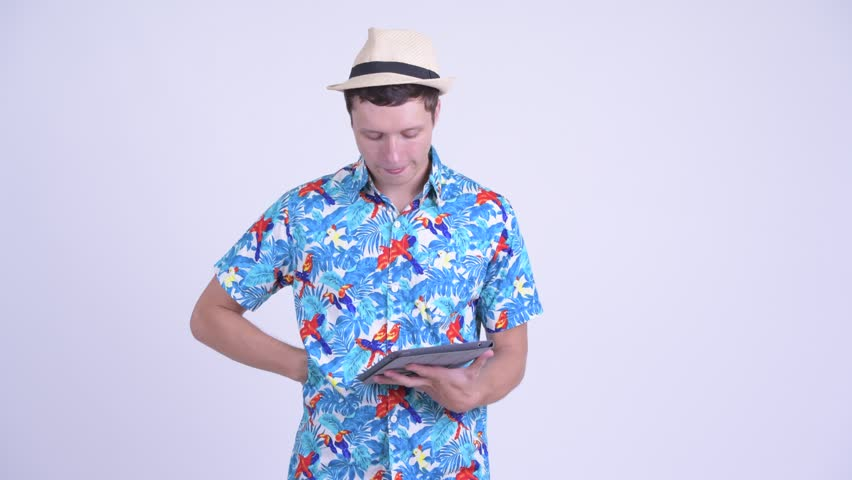 Happy young handsome tourist man thinking while using digital tablet   Shutterstock HD Video #1029224570