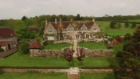 Aerial droneshot flight. Big old manor house countrylike. Jurassic coast, WestBay near Bridport, UK Great Britain
