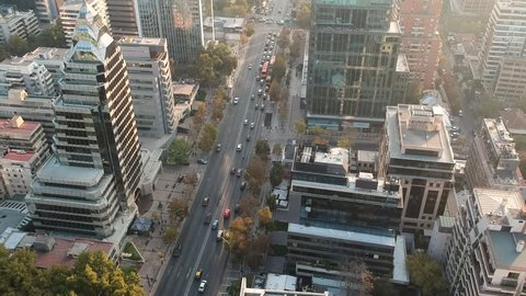 Aerial Drone Shot of street flying across concrete jungle, Santiago Chile