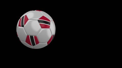 Soccer ball with the flag of Trinidad and Tobago flies past the camera, slow motion, 4k footage with alpha channel