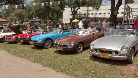 North district, israel - may 4, 2019: old mg mgb roadster cars in various  colours and in mint condition parked at an open air display car meeting