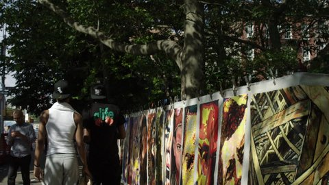 NEW YORK - MAY 30, 2015: street art, portraits, famous people, celebrity paintings, drawings, pictures, Marilyn Monroe, JFK, Bob Marley, Malcolm X, slow motion 4K, NY. West Village is in NYC, USA.