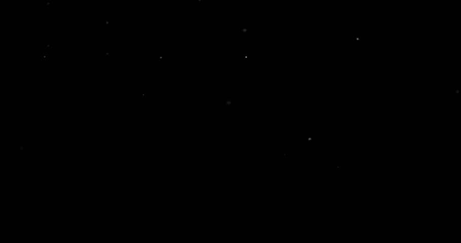 Flying dust particles on a black background | Shutterstock HD Video #1029416270