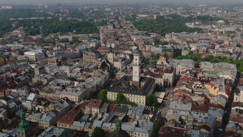 Aerial Roofs and streets Old City Lviv, Ukraine. Panorama of the ancient town. City Council, Town Hall, Ratush, old church Lviv Latin Cathedral. Drone shot