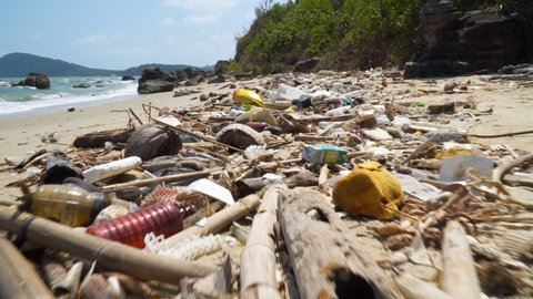 Large amount of plastic trash littering the ocean shore. Concept of Ocean Rubbish And Pollution Environmental problem