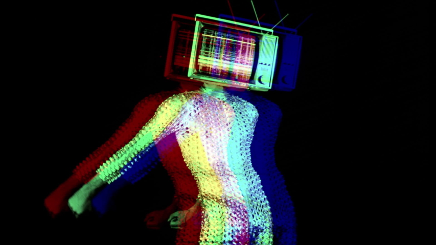 Mr tv head cool man in a silver costume dancing the floss dance with a television as a head. the tv is has video static and noise playing on it. | Shutterstock HD Video #1029568010