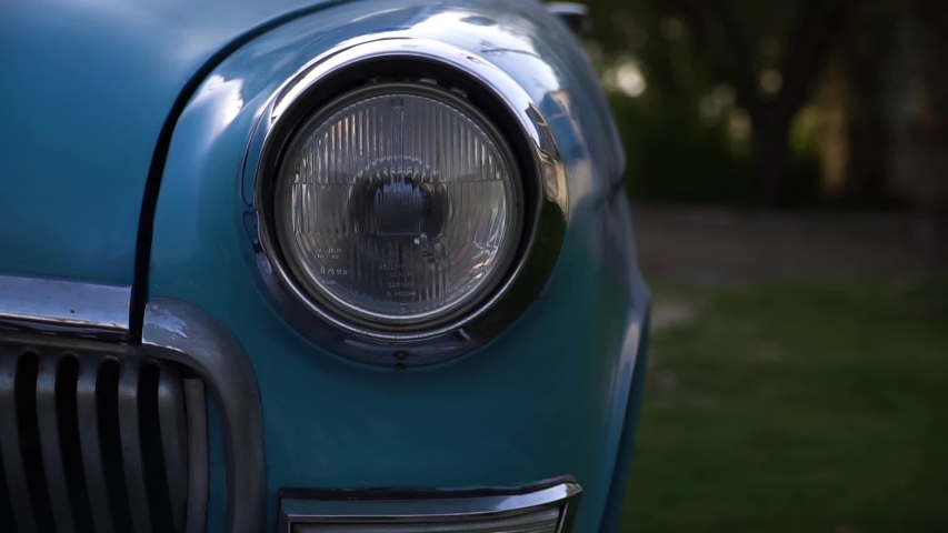 Close up of headlight of old classic car.