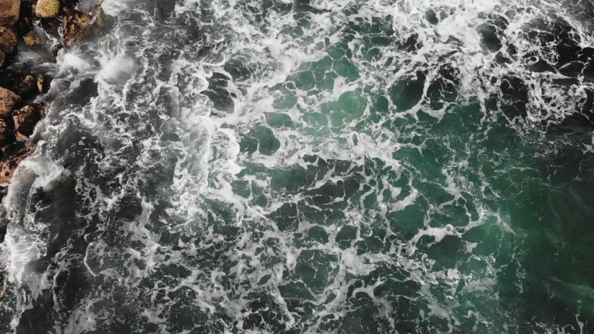 Bird's eye view of oceanic waves hitting the rocky shore of Northern Ireland   Shutterstock HD Video #1029687980