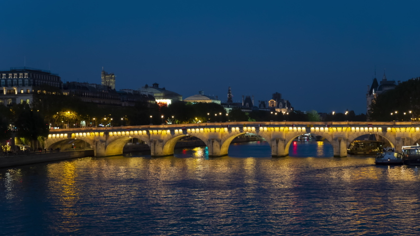 Paris, France - 29 April 2019. Night panoramic view of the Seine river, Site island and Neuf bridge | Shutterstock HD Video #1029764270