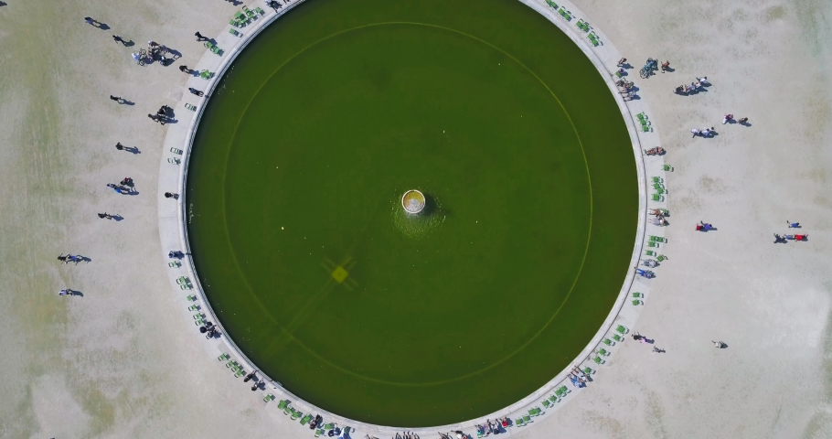 Aerial shot beautiful top view of the circular alley in the middle of the seated bright green grass, Paris | Shutterstock HD Video #1029815960
