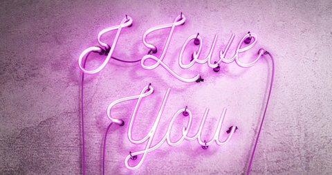 Realistic neon sign that says I Love You the neon sign has flickering effects on the neon tubes on a grey concrete wall.