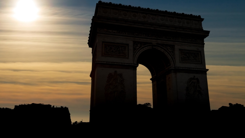 The Arc de Triomphe de l'Etoile or Triumphal Arch of the Star: Time Lapse at Sunset, one of the most famous monuments in Paris, France | Shutterstock HD Video #1029821240