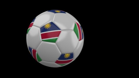 Soccer ball with flag Namibia flies past camera, slow motion blur, 4k footage with alpha channel