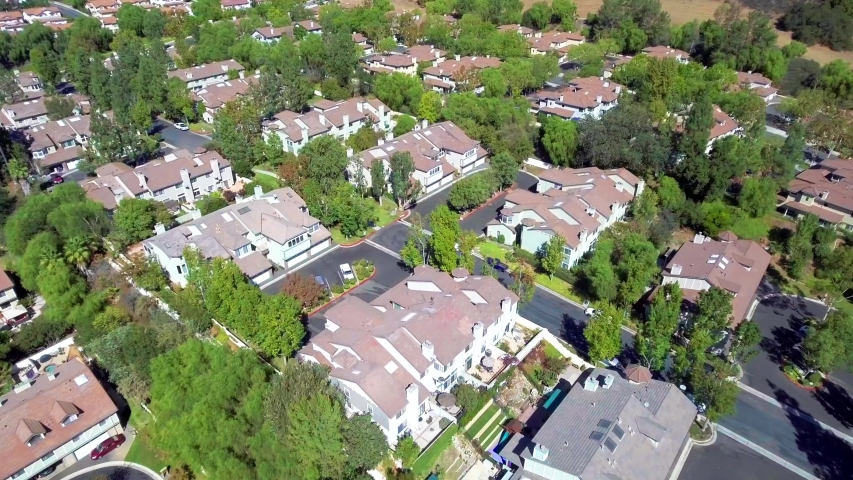 Aerial of a community of home in a suburbia neighborhood on Los Angeles. 4k drone | Shutterstock HD Video #1029887930