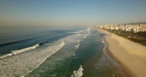 Sand and ocean view from the sky at Barra da Tijuca Beach, Rio de Janeiro - Brazil.