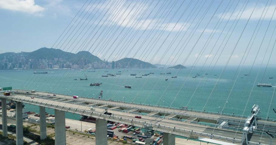 View of Hong Kong Island through Stonecutter bridge. Aerial drone shot | Shutterstock HD Video #1029987080