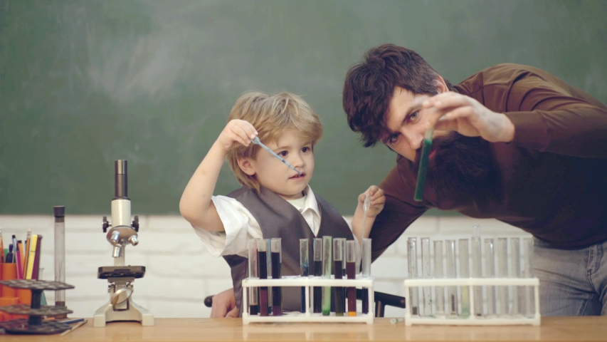 Ready for school. Chemistry The Science Classroom. Happy little scientist making experiment with test tube   Shutterstock HD Video #1030042280