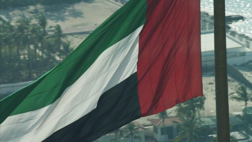 Aerial National Flag flying Pole Urban District Dubai UAE   Shutterstock HD Video #10300850