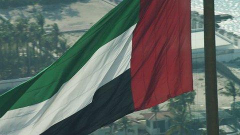 Aerial National Flag flying Pole Urban District Dubai UAE