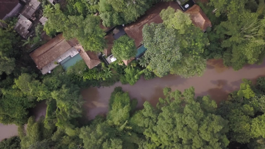 Panoramic aerial view of tropical river in the middle of the jungle, spa hotel | Shutterstock HD Video #1030092170