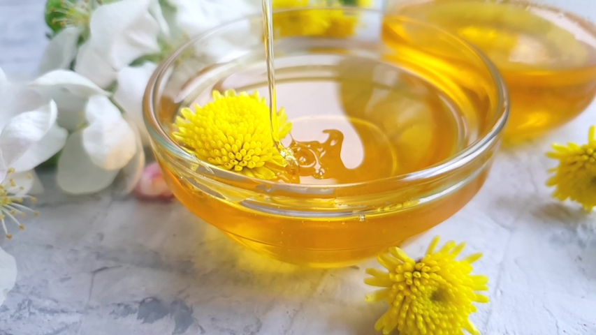 Fresh honey dripping blooming apple tree slow motion   Shutterstock HD Video #1030098530