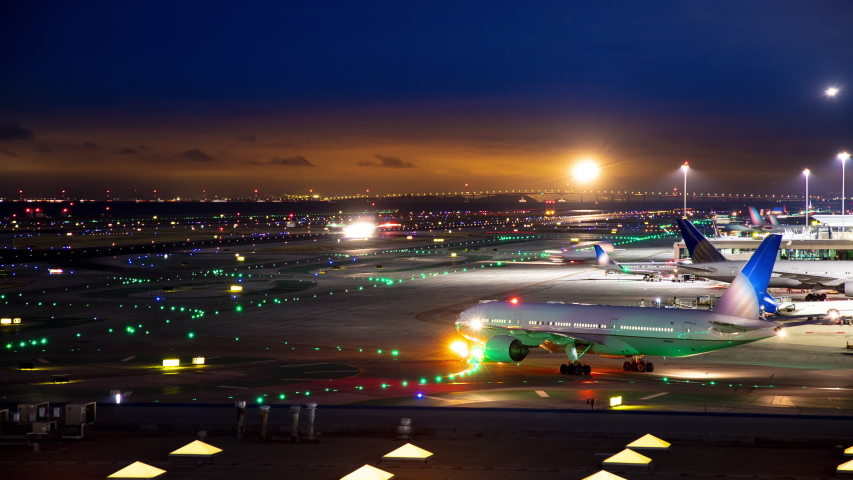 Generic Unmarked International Airport Airfield Night Timelapse with Moving Lights from Commercial Jet Airliners near San Francisco California United States of America