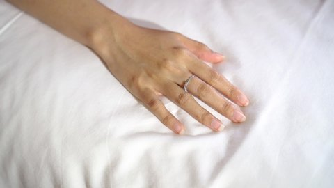 Hand sign orgasm girl enjoying sensual, making love, having sex passion in bed room. Sex and orgasm concept.