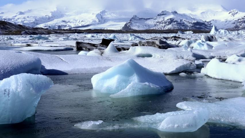 Timelapse of Icebergs moving in Jokulsarlon Ice Lagoon Iceland   Shutterstock HD Video #1030216880