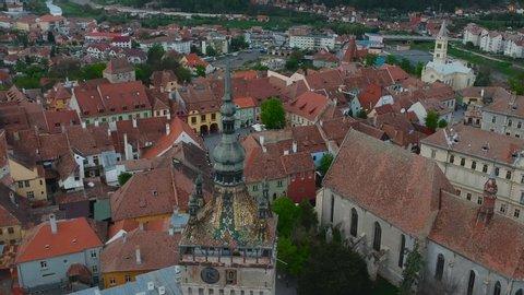 Cinematic Drone Aerial of Turnul Cu Ceas Clock Tower 14th Century Citadel Unesco World Heritage in Sighisoara City Transylvania Romania on Spring Day