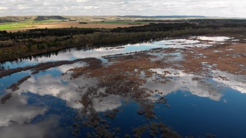 Aerial panning view of backwater of the Wisconsin river with beautiful clouds in the reflections