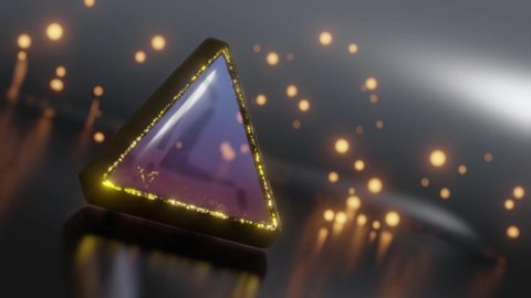 Abstract 3d animation of rotating colorful pyramid crystal with gold edging and glowing orange particles on background.
