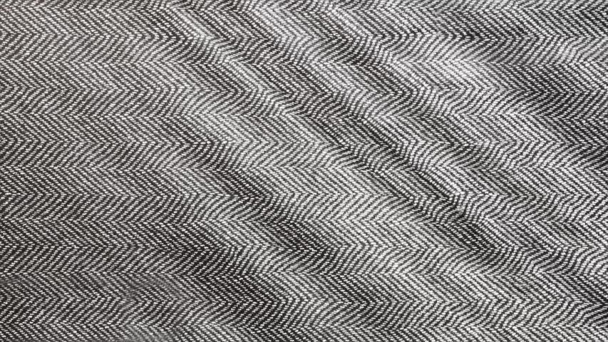 Herringbone background, macro shot of tweed fabric cloth waving.  | Shutterstock HD Video #1030350830