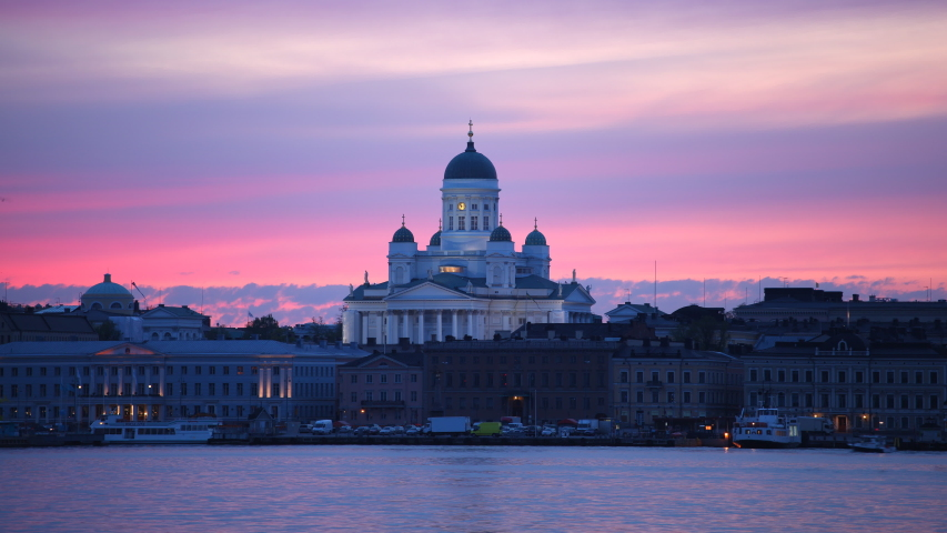 HELSINKI, FINLAND - MAY 21, 2011 Time Lapse Helsinki Skyline Iconic Landmark Ferry Boats Transport Dusk to Night