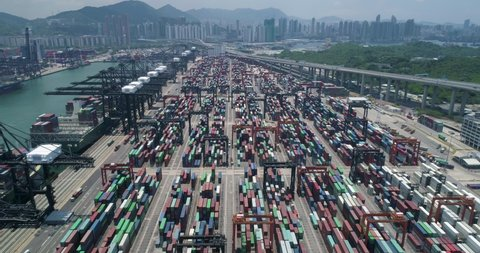 Overhead of transport trucks with containers in container park, global transport network international supply chain commercial logistics industry Aerial shot