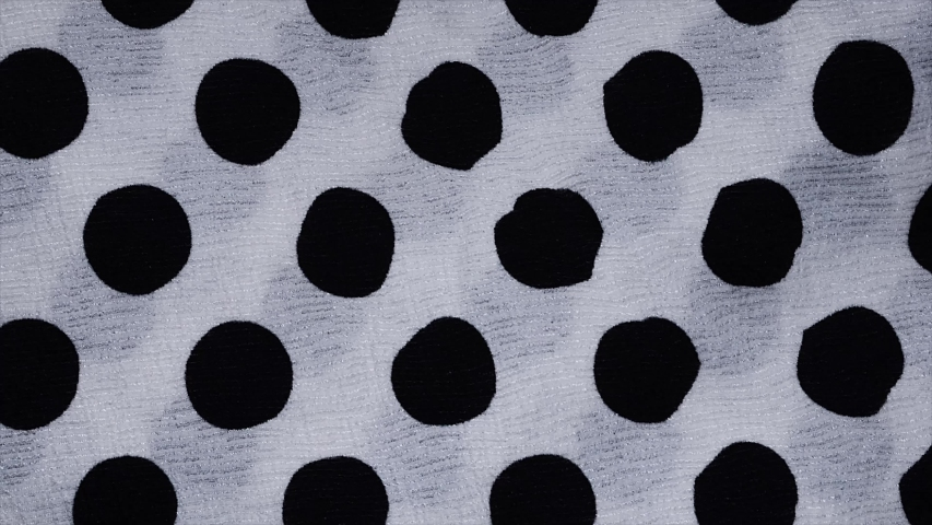 Spotted fabric cloth close up shot. Black dots on white background, Monochrome pattern.  | Shutterstock HD Video #1030554200