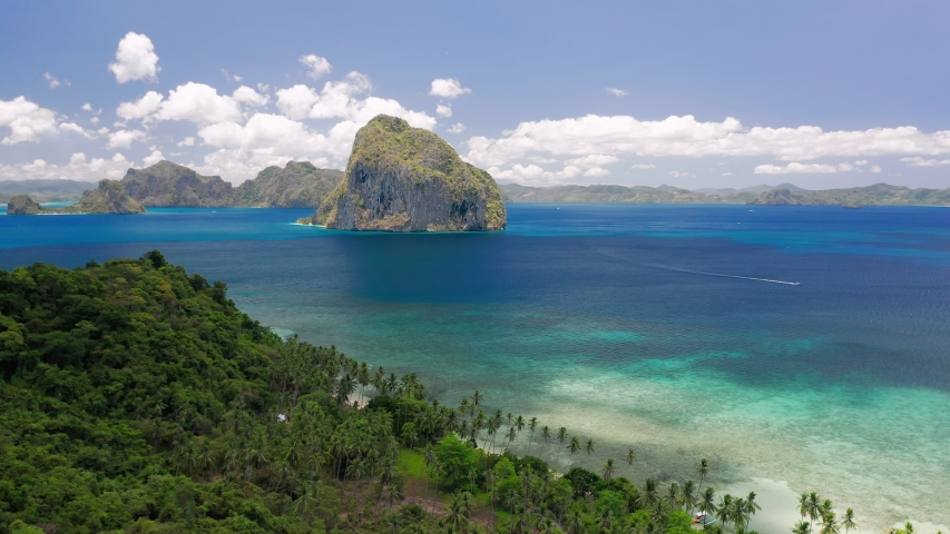 El Nido, Palawan, Philippines. Aerial drone panoramic coastline view of Bacuit bay with beautiful seashore, blue water, tropical islands. . Summer and travel vacation concept | Shutterstock HD Video #1030627460