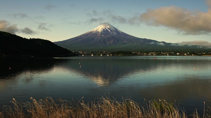 Fuji mountain and Kawaguchiko lake in morning, cloud flow on the air | Shutterstock HD Video #1030673570
