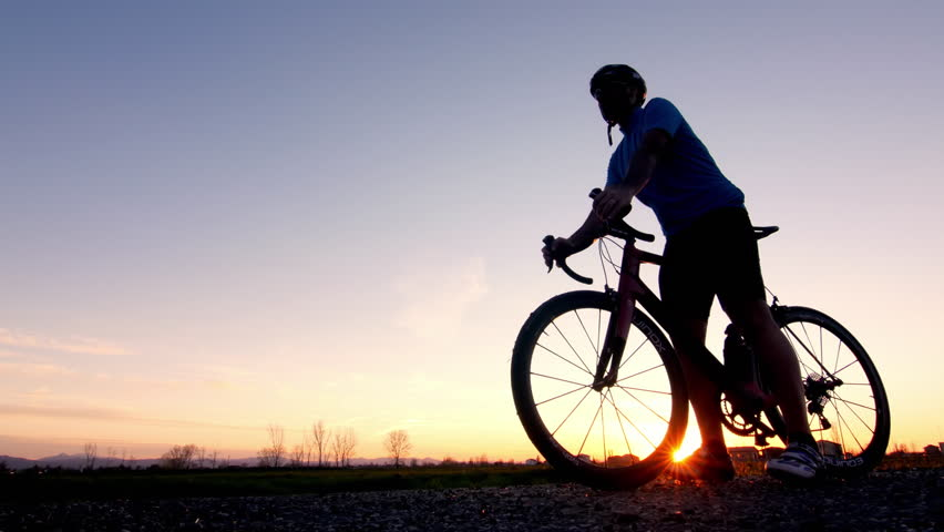 Man rides bicycle on starting for training working out  | Shutterstock HD Video #10306760