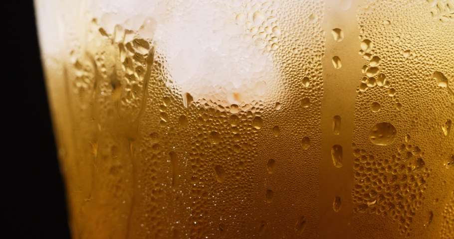 Beer Bubbles And Foam Close-up | Shutterstock HD Video #1030737170