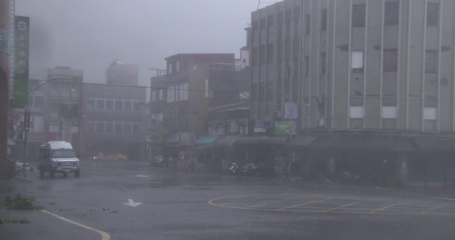 SUAO, TAIWAN - OCTOBER 2015: Violent Wind Flying Debris Hit City As Hurricane Eyewall Makes Landfall - Suao