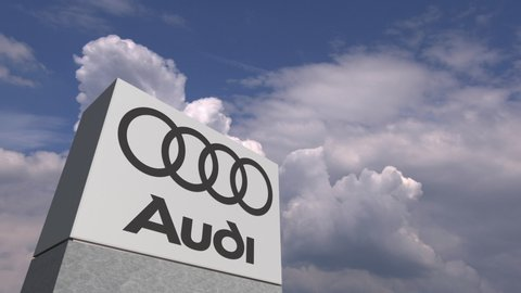 Logo of AUDI on a stand against cloudy sky, editorial animation. USA 2019