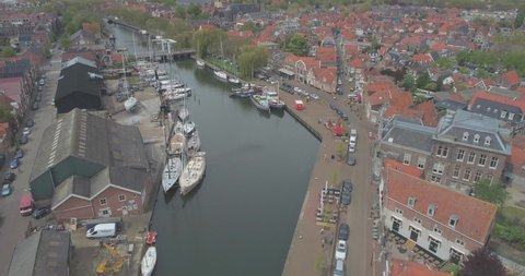Aerial towards sailing boats moored in the historic Dutch town Enkhuizen in North Holland the Netherlands