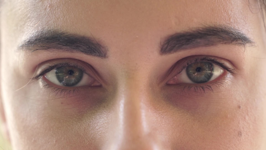 Close-up of beautiful green female eyes. The girl opens her eyes | Shutterstock HD Video #1030891190