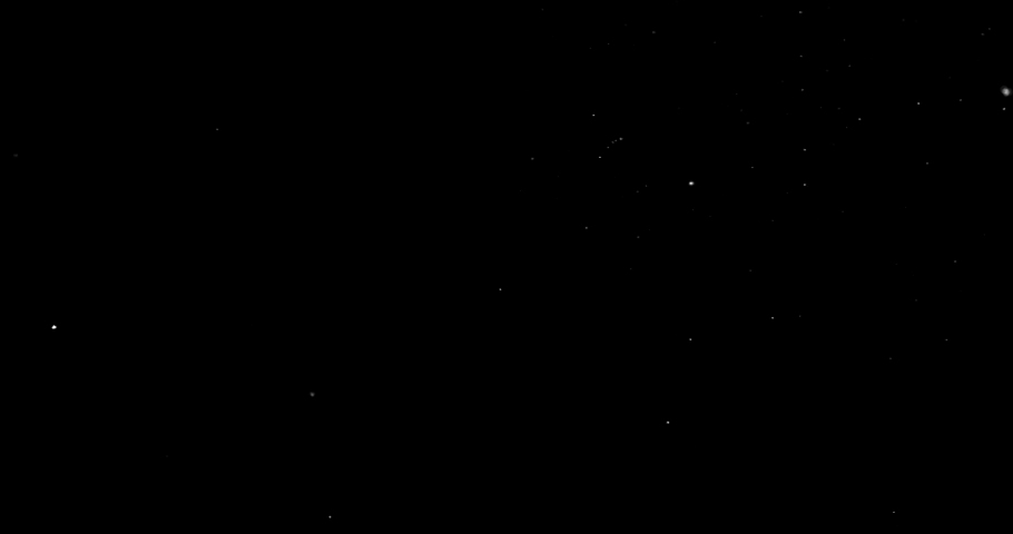 Flying dust particles on a black background | Shutterstock HD Video #1030967510