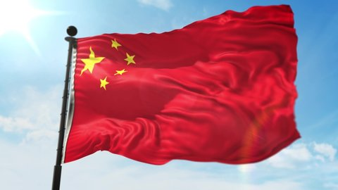Waving Chinese Flag in front of blue sky