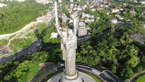 Ukraine Kiev 29.05.2019. Majestic monument of the motherland. The camera is close to the monument and moves from left to right. Behind the monument is a panorama of the city of Kiev.