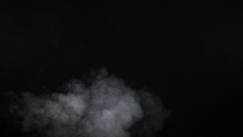 Shooting of white cigarette steam on black background   Shutterstock HD Video #1031501780