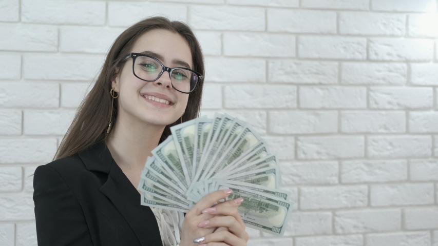Happy girl with cash. Business woman waving a money fan. | Shutterstock HD Video #1031662280