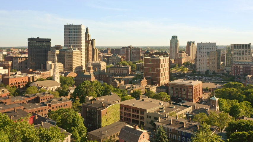 Late afternoon drone footage of Providence, Rhode Island with uplift camera motion from Prospect Terrace park, revealing the city skyline. Providence is the capital of Rhode Island. | Shutterstock HD Video #1031714540
